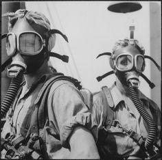 "These ""Top Women"" worked at Gary's (Indiana) U.S. Steel Works during World War II. Their job was to clean up, at regular intervals, the tops of twelve blast furnaces. As a safety precaution, they wear oxygen masks."