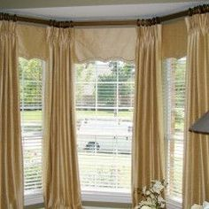 Inside mount valances or cornices with drapery layered over the top.  Really different!