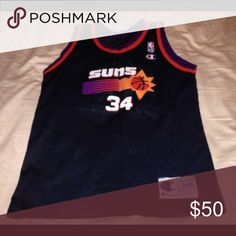 Vintage champion phoenix suns Barkley jersey sz L Thank you for viewing my listing, for sale is a vintage, black, Phoenix Suns, Champion brand, sir Charles Barkley screen printed jersey.   Jersey is in great condition with no rips or stains.  If you have any questions or would like additional photos please feel free to ask. This jersey is for a youth.   Sz: L 14-16  Team: Phoenix Suns  Player: Charles Barkley   From under one arm to under the other measures appx from the top of the stroller…