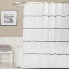 @Overstock - Lush Decor Twinkle White Shower Curtain - Add a little luxe to your bathroom with the Lush Decor Twinkle white shower curtain. This 72-inch long by 72-inch wide curtain features five tiers of white fabric gathered into soft folds and divided by four bands of sparkling, silver sequins.  http://www.overstock.com/Bedding-Bath/Lush-Decor-Twinkle-White-Shower-Curtain/7720683/product.html?CID=214117 $32.49