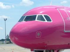 front of a pink airplane