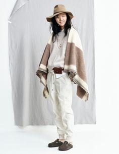 madewell fall 2015 #fallmadewell. cream drawstring pants, large stripe poncho blanket, birkenstock clogs, brown fedora, leather belt bag.