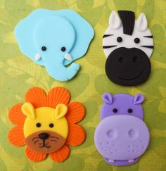 12 JUNGLE ANIMALS. Edible Fondant Cupcake Toppers - Elephant, Zebra, Lion & Hippo. $18.00, via Etsy.