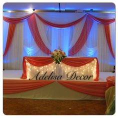 Stunning Coral & White Wedding Draped Backdrop &  Sweetheart Table by Adelisa Décor.