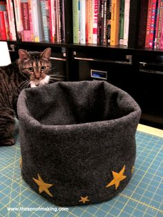 To give my cats a comfy place where they can be close, yet out of harm's way while I'm working, I designed this simple, compact 3-in-1 cat bed for my desk.