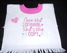This new pullover towel bib is 100% Cotton terrycloth. It has a contrasing rib knit neck opening. The bib measures 11 x 18 including fringe. It features a embroidered saying. Can be done in any colors.
