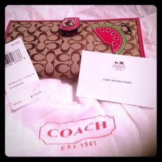Authentic Coach Wallet~ NWT~Beautiful  Authentic Coach wallet New With tags and original wrapping ~ even its Dust Bag ! Has an outside zipper pouch on back and inside 2 open slip pockets n one side and one n the other ~  11 credit card slots and an ID slot ~  on the front is a cute Watermelon slice  Coach Bags Clutches & Wristlets