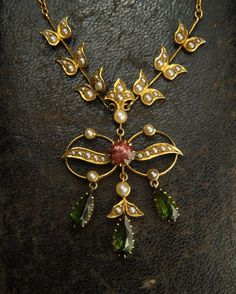 An Edwardian tourmaline & pearl necklace circa 1910. Featured in the 'Latest Arrivals' at CJAntiquesLtd.com