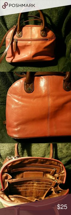 Orange Leather Tignanello handbag Soft supple leather, two small pockets and two zipper pockets with several card slots inside.  Some discoloration on both front and back from use - shown in photos.  Has been loved but still in nice condition. Tignanello Bags