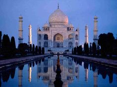 Taj Mahal, India Photograph by Michael S. Lewis, National Geographic The Taj Mahal is partially lit by the sunrise in Agra, India. Places Around The World, Oh The Places You'll Go, Cool Places To Visit, Places To Travel, Around The Worlds, Travel Destinations, Taj Mahal India, Le Taj Mahal, Agra