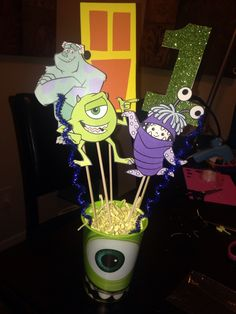 Monsters Inc centerpieces, my sons first birthday is next month so I made this. 2 Year Old Birthday Party, Baby First Birthday, Birthday Bash, First Birthday Parties, First Birthdays, Monster Inc Party, Monster Birthday Parties, Monsters Inc Centerpieces, Monster University Party