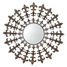 Add a dramatic mirror and create a striking focal point to any room. Antique brown metal fleur de lis rays fan out from the mirror's beveled sun center. Creates a memorable display of wall art for today's modern interiors.
