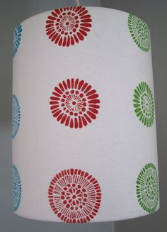 Modern Flower Hand Printed Lampshade- pendant drum hanging lamp shade- red, blue, green, yellow- made from hand printed fabric. $60.00, via Etsy.