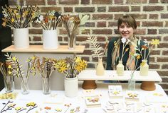 Anna Wiscombe, craft fair display - love the upside down flower pot shelf supports