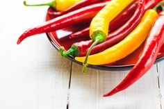 If you can't stand the heat, opt for chillies that add flavour Yellow Chili Peppers, Spicy, Vegetarian, Stuffed Peppers, Plates, Stock Photos, Vegetables, Red, Art School