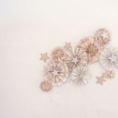 decorate cards and packages with stars made of book pages, sheet music, gold paint, and silver glitter