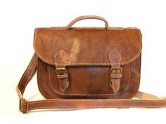 This handcrafted leather Messenger Bag is compact but oh so handy and stylish. A handsome, accessory that will beautifully accentuate your wardrobe. Perfect for your iPad, books, documents and more. F