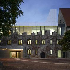 "Architecture: Moritzburg Museum Extension by Nieto Sobejano Arquitectos: "".an extension to a museum inside a ruined castle.The architects inserted the extension above the century stonework of the Moritzburg Museum."