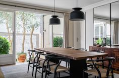 Modern dining room space with pendant lights