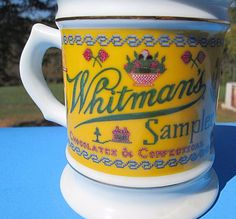 This cute mug has a reproduction Whitman's Sampler ad. Made in 1982. Trimmed in 18 karat gold. Cup has a picture of the famous candy box and also says, Chocolates & Confections. Type: Collectible Mug. | eBay!