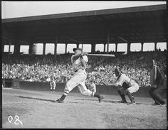 Red Sox batter Eddie Morgan swings and misses against Washington Senators at Fenway Park in 1934. Washington catcher is Eddie Phillips (#32).