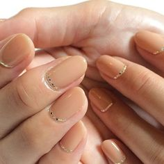 Beige nail with a touch of gold .