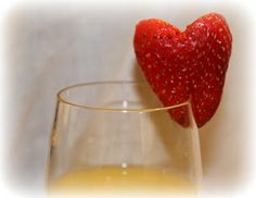 heart shaped strawberry for a champagne mimosa for Valentine's Day breakfast in bed & other ideas