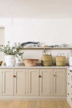 Helix Silestone worktops, muted Shaker cupboards and copper hardware in this lovely deVOL Kitchen