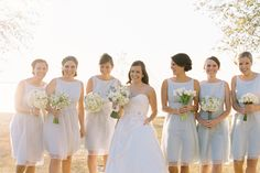 Great to see different flowers within the same color palette used for the bridesmaids. Way to showcase their individual personalities in the florals!