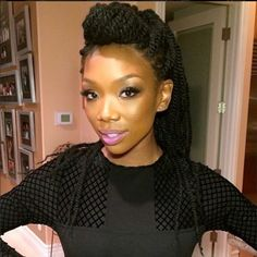 Braided up or twisted up Brandy looks good in  up do's.