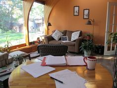 Jeannie Mobley. I have a desk and an office, but I work all over the house, and in the back yard. A few years ago, we added a sunroom onto the back of our house, and that has become my favorite workspace. I get up early, put on my robe, make a big pot of coffee, feed the dog and cats, and get to work. I write for three or four hours while the rest of my family sleeps in.