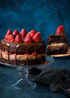 Strawberry Chocolate Cake Recipe on twopeasandtheirpod.com Chocolate cake with chocolate frosting, chocolate ganache, and sweet strawberries! This is the BEST chocolate cake recipe!