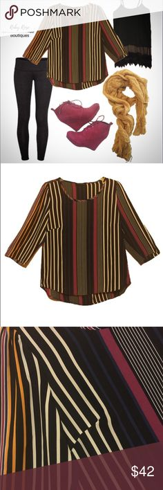 Ezra Brand Striped Top Gold, maroon, black, blue, and white. These vertical stripes are perfect to pair with some basic pieces such as black leggings and booties. This top is waist length and true to size (medium fits size 6-8). Feminine and professional. Ezra boutique brand. Ruby Rose Boutiques welcomes reasonable offers and bundles! Sorry, but we are unable to trade at this time. ~{We are ALL beautiful.}~ Follow us on Instagram @rubyroseboutiqs for fun, fellowship, and fashion! Tops