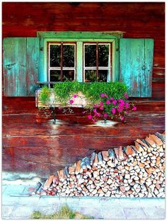 turquoise shutters - Burgundy walls & Multi-colored Kindling... Sweet.