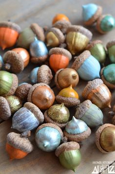 painted acorns for Thanksgiving decor // holiday tablescape DIY ---nice for Christmas container or table scape even for rustic charm year round