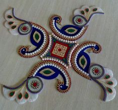 A rangoli is a colourful design made on the floor near the entrance to a house to welcome guests. At Diwali, Hindus draw bright Rangoli patterns to encourage the goddess Lakshmi to enter their homes. -Beautiful one -of-a-kind, Peacock shaped kundan rangoli for wedding and festival