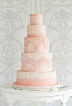 Brides.com: . Wowed by a swatch of lace fabric from the 1970s, Zoe Clark of Zoe Clark Cakes replicated the intricate pattern by meticulously hand-piping royal icing to the pale-pink tiers. £8 per slice, Zoe Clark Cakes