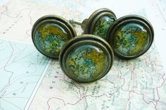 Map drawer pull, world map drawer pull, cabinet knobs, 4 pulls. $21.00, via Etsy.