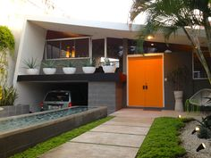 This clean midcentury modern home can be moved into right away. Includes swimming pool and gardens in front and back...