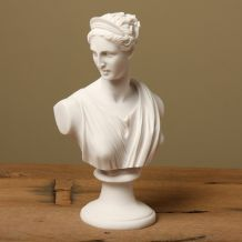 The famous bust of the Greek Mythology Goddess Diana (Artemis) the Huntress is depicted in this elegant white marble statue