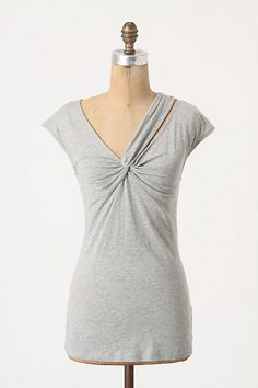 Bought this top in the pink/purpley color and very versatile.  It's a nice, long length so I can either have it untucked with jeans or tucked into a high-waisted skirt.