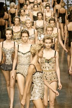 So many varieties of gold sequined dresses = amazing!  So many girls marching like an Army = kinda weird.