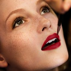 Naturally illuminated skin and bold red lips - the festive make-up look