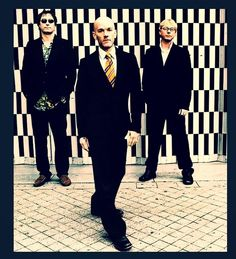 REM  Band Members...Michael Stipe, Peter Buck and Mike Mills