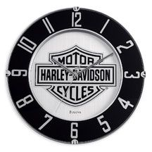 """Plastic clock with aluminum dial and glass front. Bar & Shield logo and numbers are printed on a mirrored surface. Requires one AA battery (not included). Measures 14"""" diameter. Call Wilkins to order 802.476.6104"""