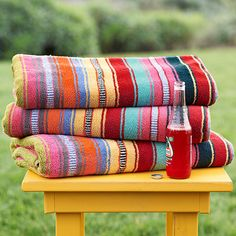 """DOUBLE-WIDE SUNDANCE STRIPED BEACH TOWEL--Stake out your tanning territory with our luxuriously plush striped cotton towel. Every bit as fluffy, absorbent and decadent as our standard towel, the doublewide is sized for sharing. 800-gram Turkish cotton. Machine wash. Imported. Exclusive. 72""""L x 60""""W."""