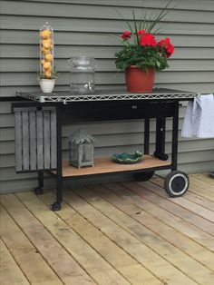 Old charcoal grill repurposed into potting bench gardens for Grill storage ideas