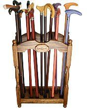 Square Cane Stand- Zebrano Wood by Royal Canes. $218.90. Made of exotic ovangkol wood, this cane stand displays the quality workmanship of the Royal Canes Company. Though simple in design, and impeccable finish highlights the dramatic color and texture of the grain. Three evenly divided sections allow plenty of space to store various types of canes, umbrellas or other items.