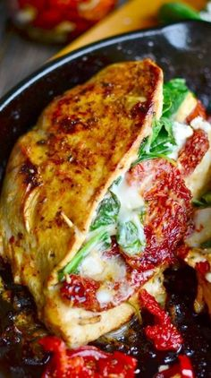 Juicy chicken breasts stuffed with spinach, cheese, and sundried tomatoes! Super quick and easy meal!