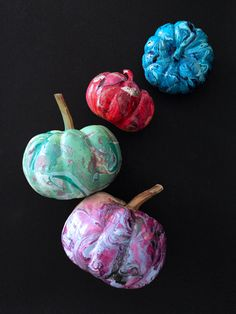 P.S.-I made this...Marble Pumpkins #PSIMADETHIS #DIY Simply pour drops of different nail polishes in a container filled with lukewarm water. Use a toothpick to create a pattern then dip the pumpkin and let dry!